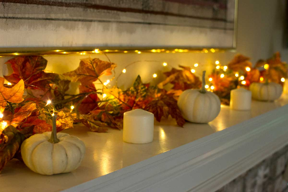 We used a mixture of copper lights, cream candles, and gourds/pumpkins for decorations