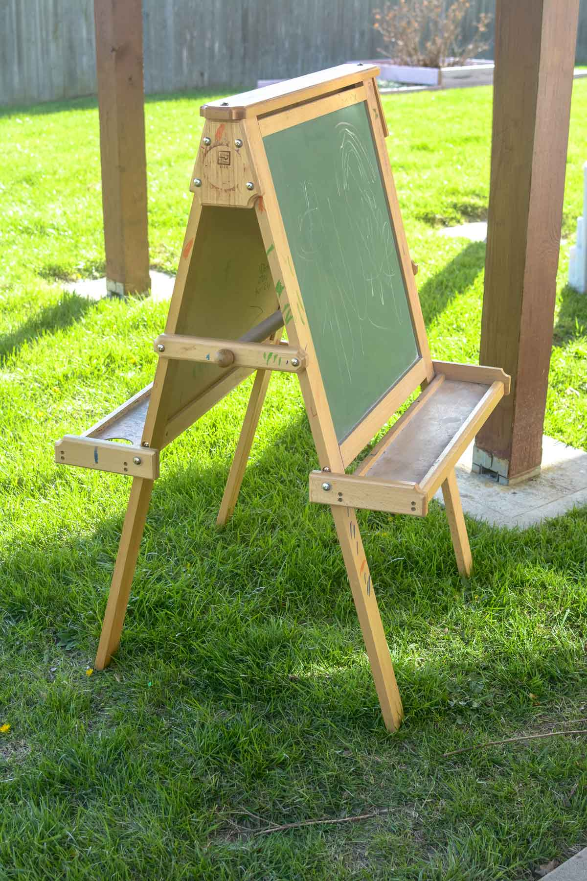 To start, my dad helped me disassemble the easel and I sanded each part until most all of the markings had been erased.