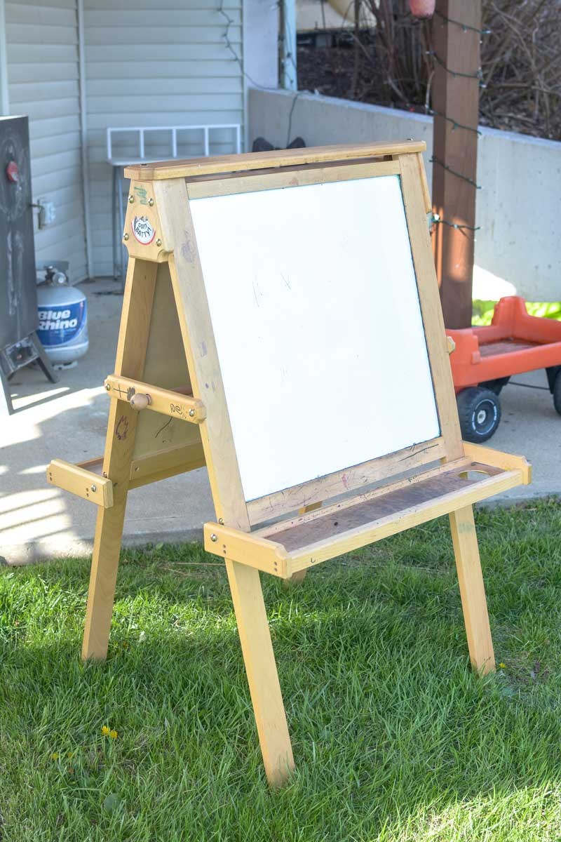 The easel was covered in stickers and had been drawn on by a very happy child.