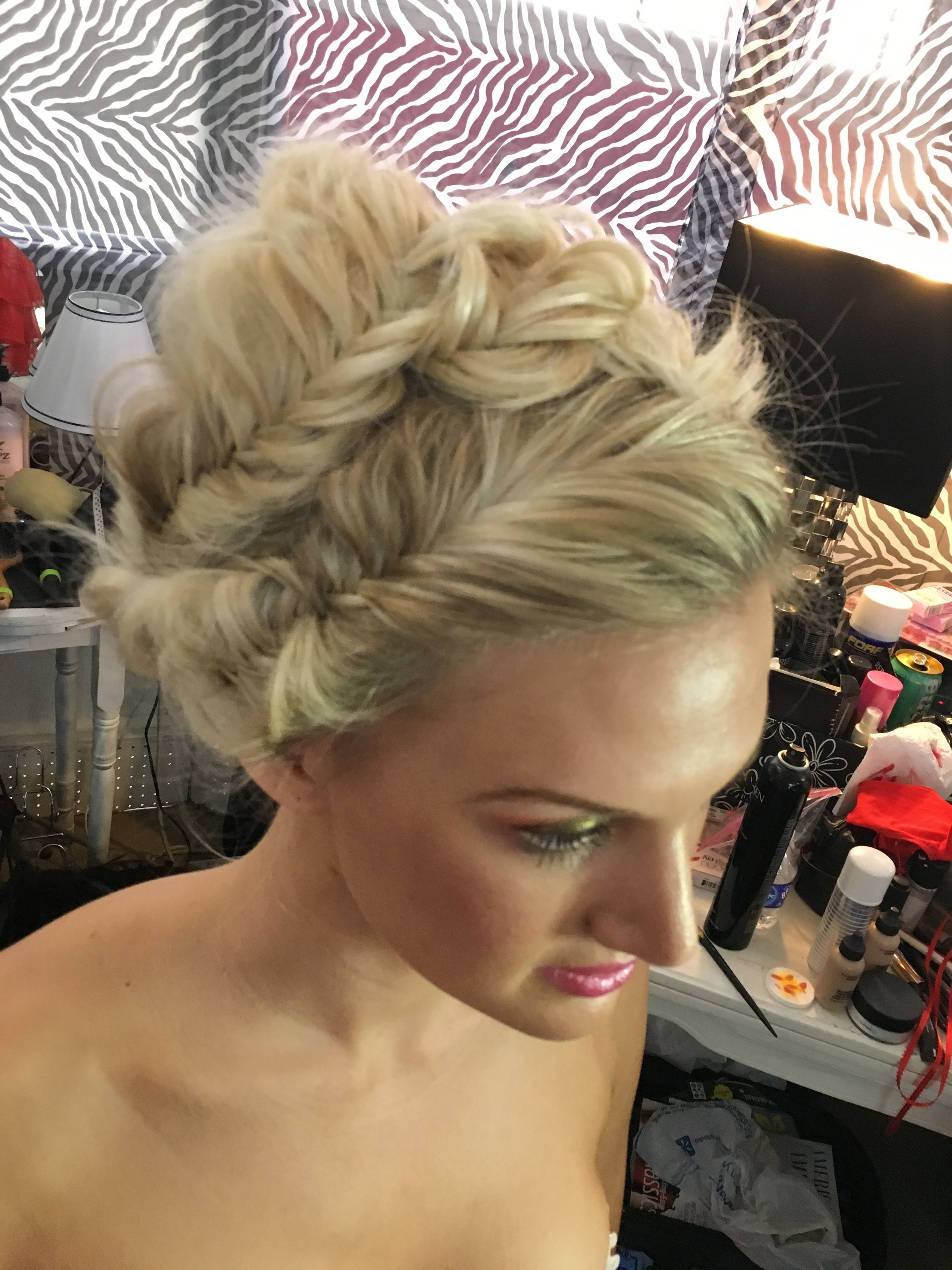 bts side view of Emily's updo