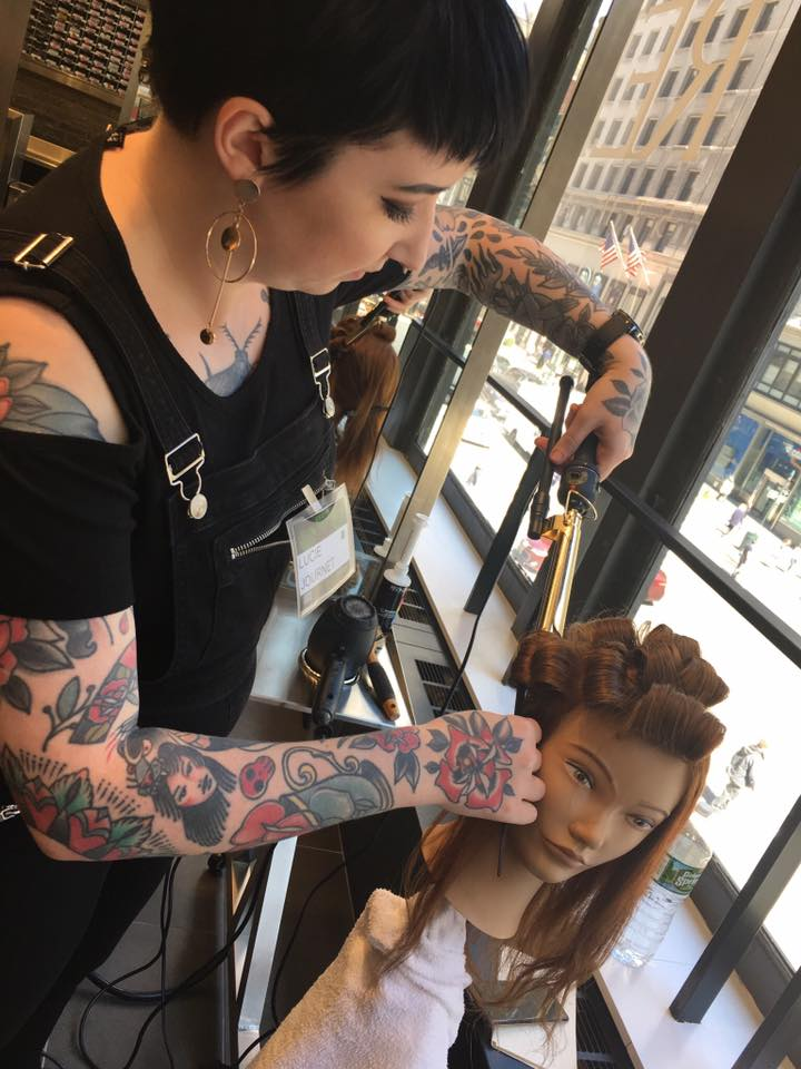 Lucie perfecting curls on mannequin