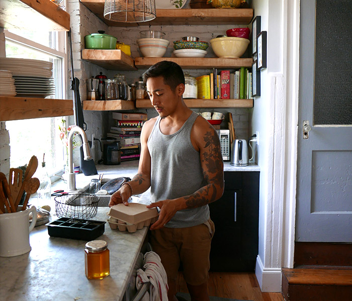 Neal in his kitchen in Philadelphia, sending us home with fresh eggs and honey, harvested from his farm in the backyard.