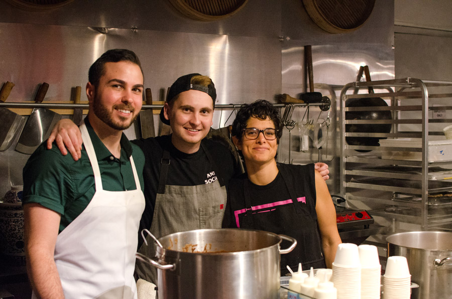 Liz Alpern (right) of Queer Soup Night, with soups (Julia's Tortilla Soup with the Works and Nik's Cocoa-Spiced Bean and Lentil Soup) prepared by Jesse Szewczyk (middle) and Kyle Bartone.