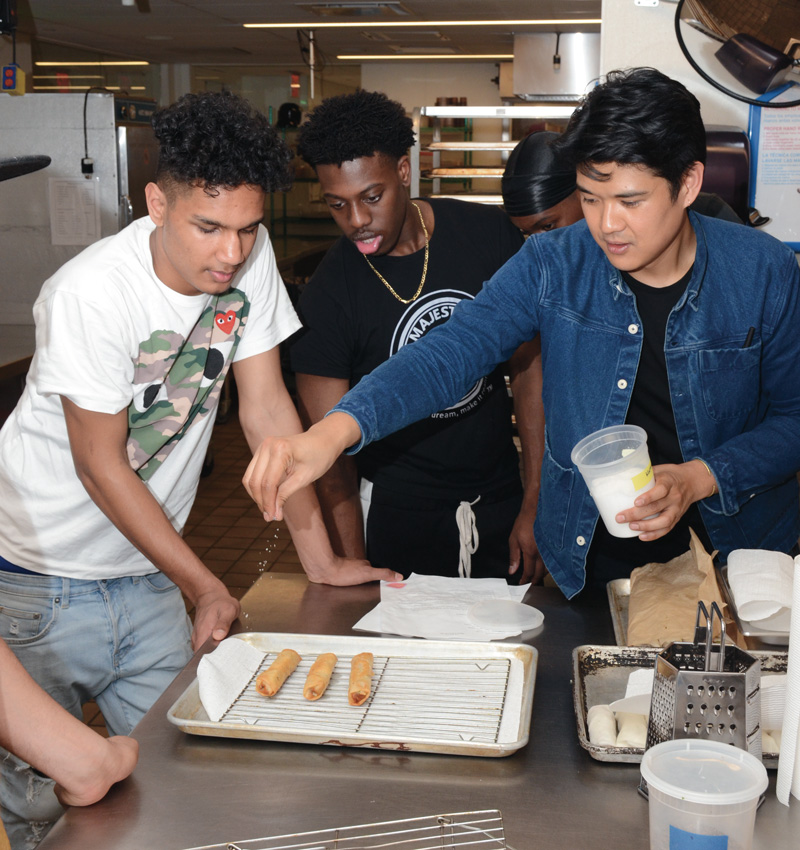 Chef Woldy Reyes in a cooking workshop with HMI Youth