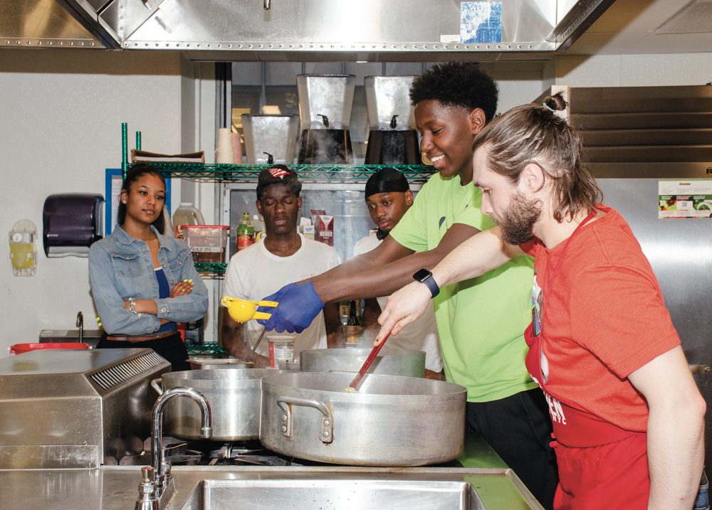 Chef Dima King conducting a Cooking Workshop with HMI Youth this spring at Food Arts Center
