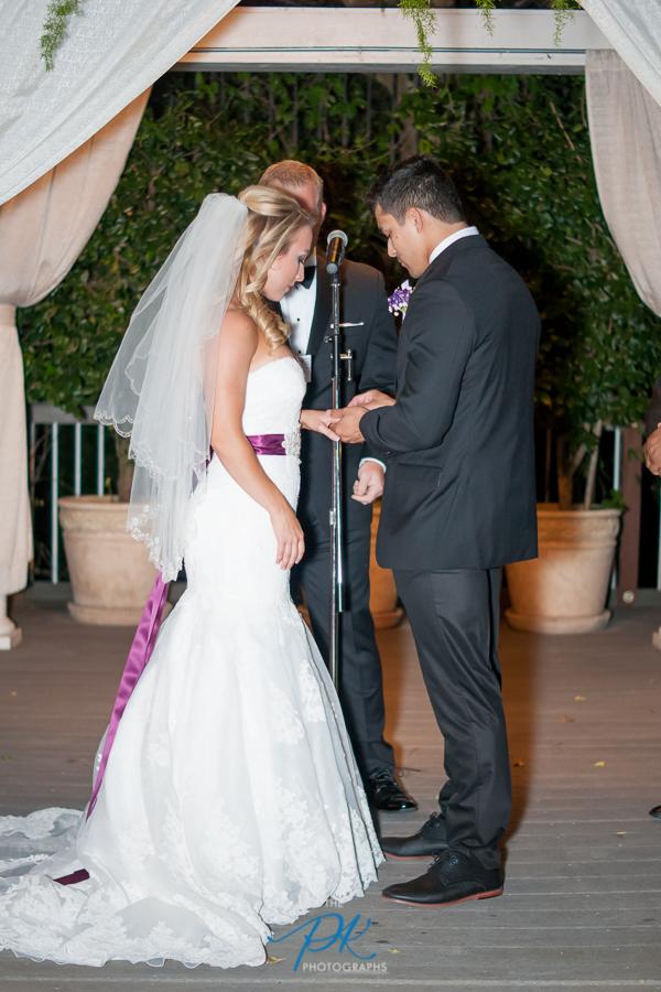 Bride and Groom Exchanging Rings -San Antonio Wedding Photographer