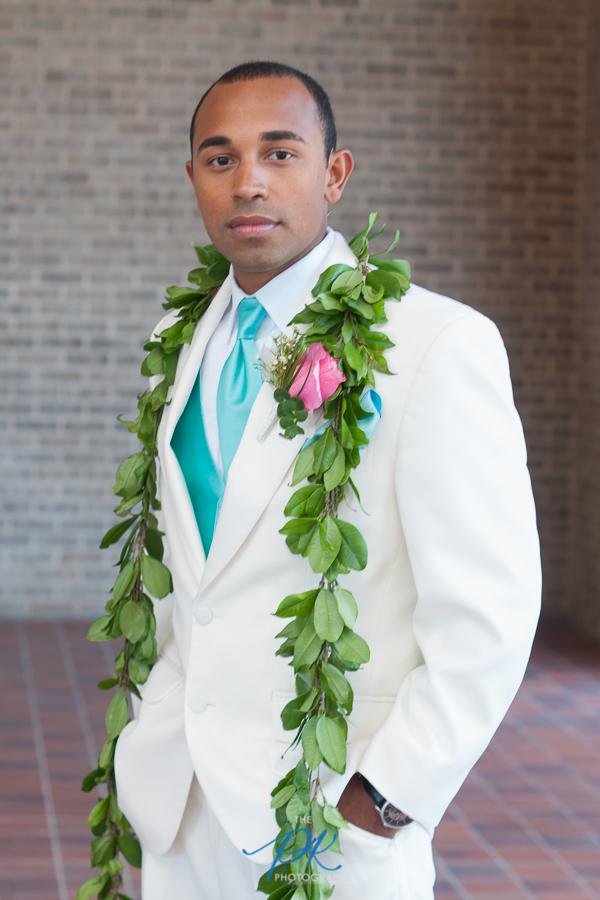 Groom in a White Suit - San Antonio Wedding Photographer