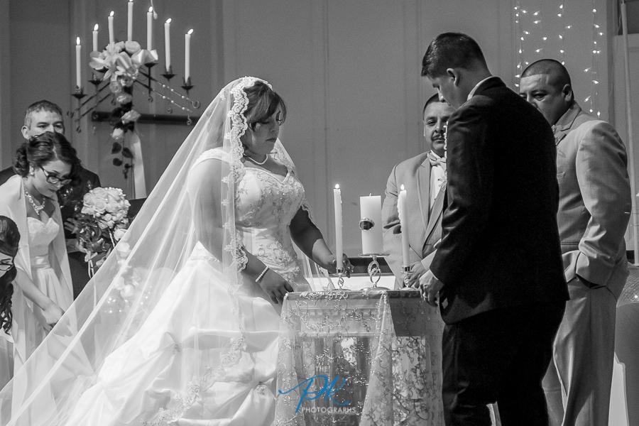 Bride and Groom Lighting Unity Candle - San Antonio Wedding Photographer