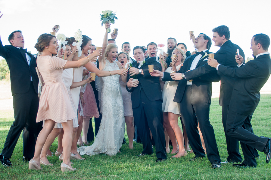 The whole bridal party gathered around to celebrate the newly weds with champagne.