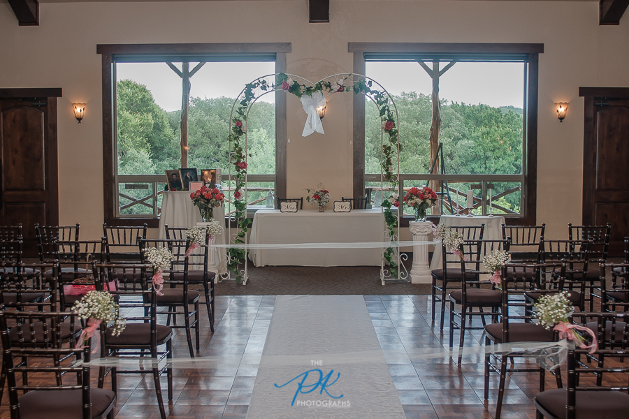 The quaint ceremony was overlooking a picture-perfect wooded lawn, complete with a strutting peacock.