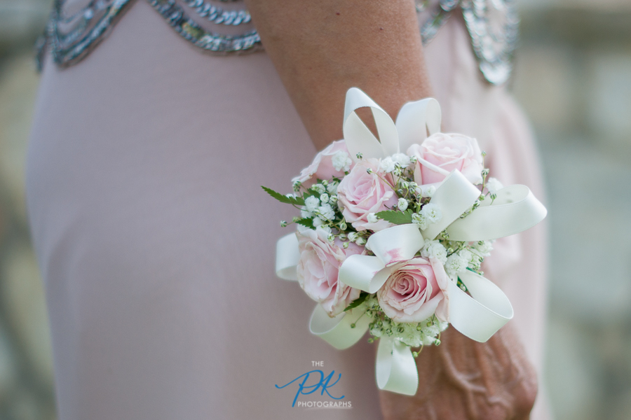 The corsages chosen were different from the other flowers, yet blended in perfectly.