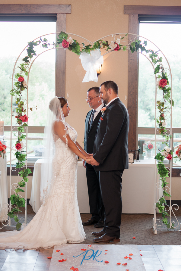 Standing under the archway to say their wedding vows.
