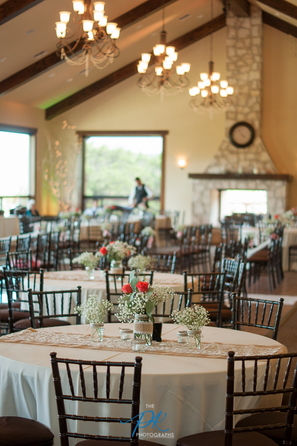 The reception tables were decorated with burlap and lace, beautiful mason jars, and had quite the country feel.