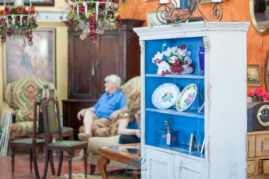 Customers enjoy the atmosphere and unique furniture, decor, and artwork for sale.
