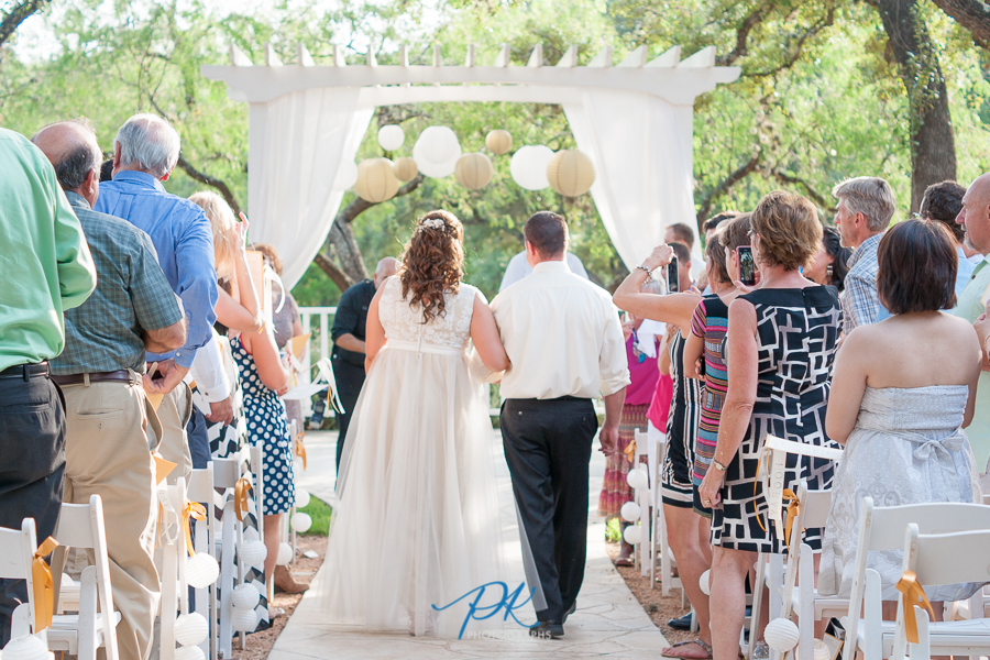 Denise and Brian walked up the aisle together at the start of their wedding ceremony.