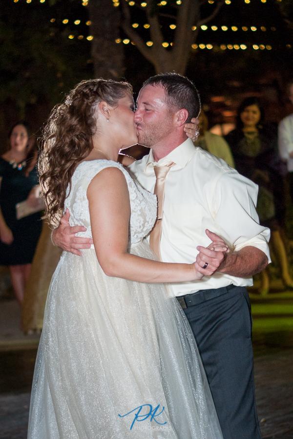 gardens-old-town-helotes-bride-groom-dancing-wedding-reception-kiss.jpg