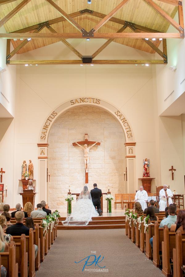 bride-groom-wedding-marriage-ceremony-st-joseph-catholic-church-spring-branch-texas.jpg