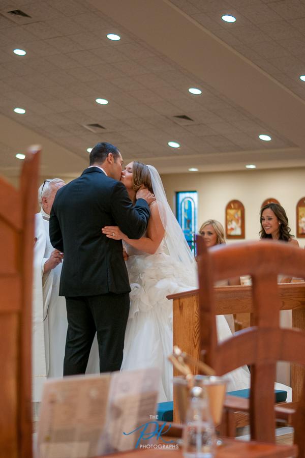 bride-groom-first-kiss-san-antonio-wedding-photographer.jpg