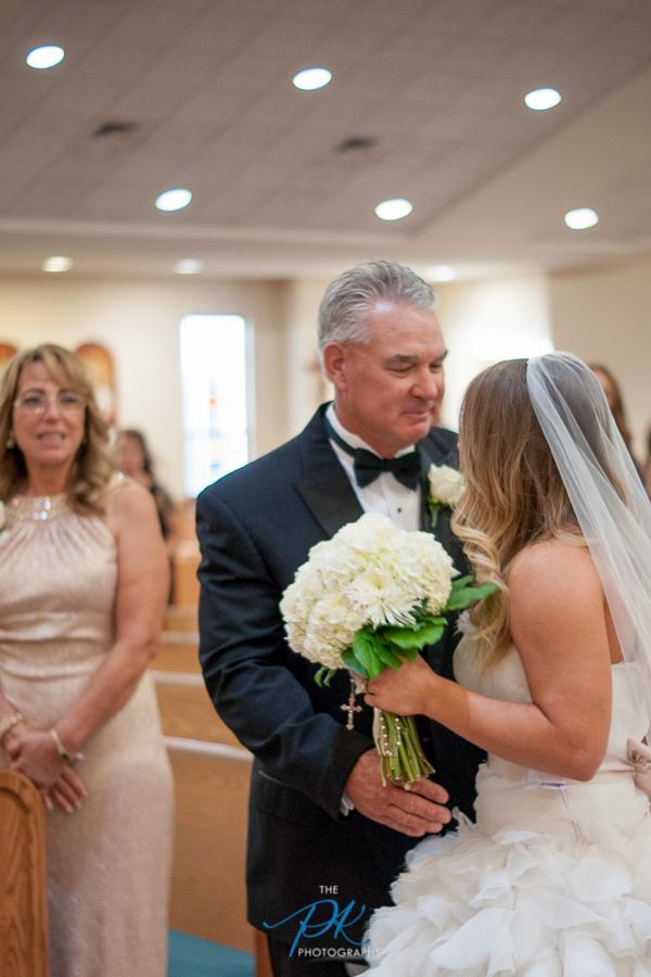 father-giving-away-bride-st-joseph-catholic-church-spring-branch-tx.jpg
