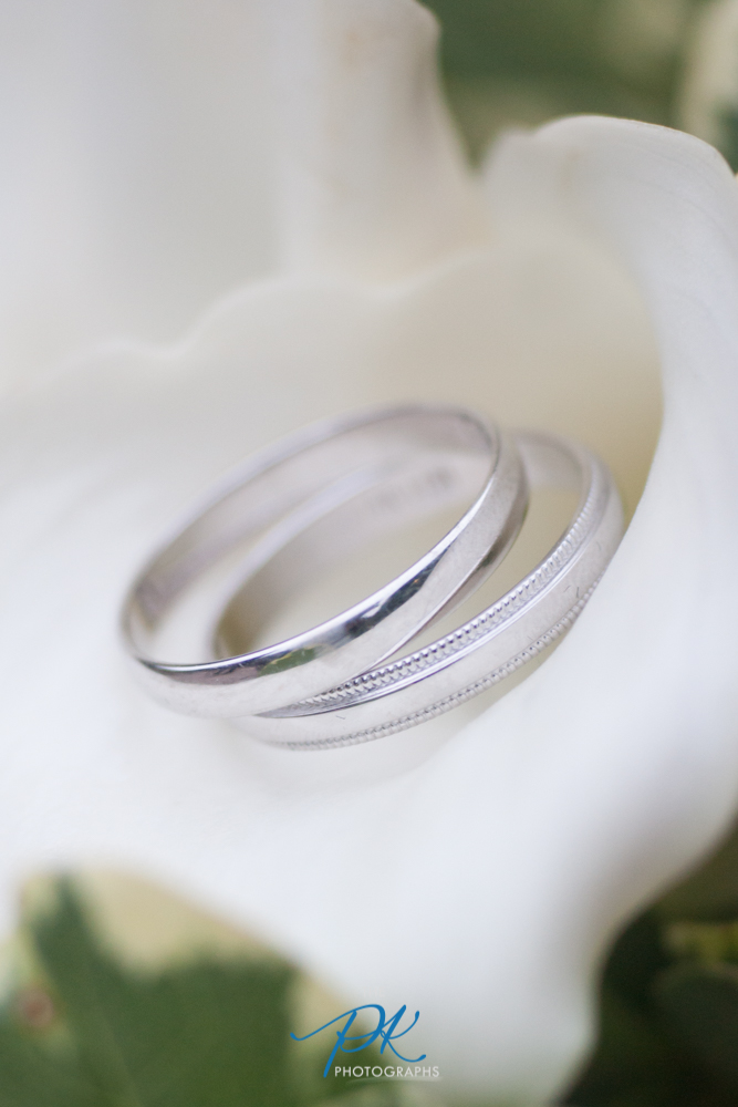 These two brides had very similar and simple rings, with black and white as their wedding colors. Shooting the rings inside one of the all-white flowers was the perfect way to showcase their rings, while tying it into the atmosphere of their wedding day. Shooting with my 100mm lens, at f/3.2, ISO 640 and shutter speed 1/100th of a second I was able to use the natural early evening light and keep the flower and background very soft, allowing the rings to dominate the image.