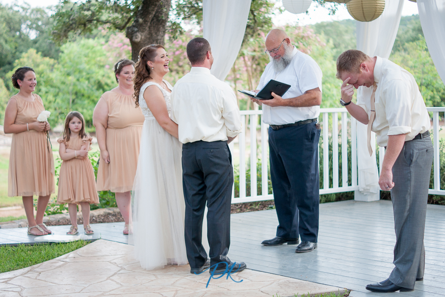 Bridal party laughing during the wedding ceremony.