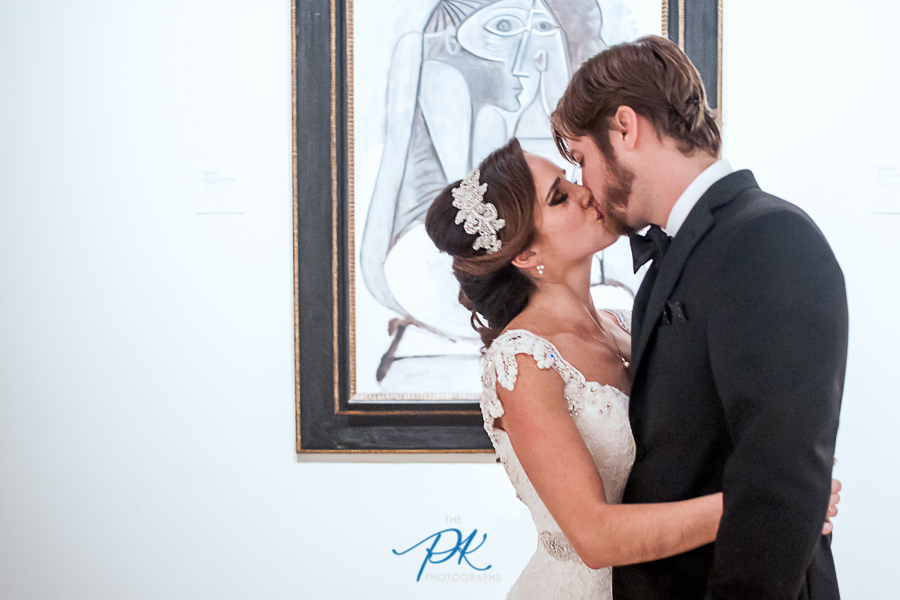 Bride and Groom Photographed Kissing in Front of Pablo Picasso's 1958 Femme Accroupie (Crouching Woman) at the McNay Art Museum in San Antonio, Texas