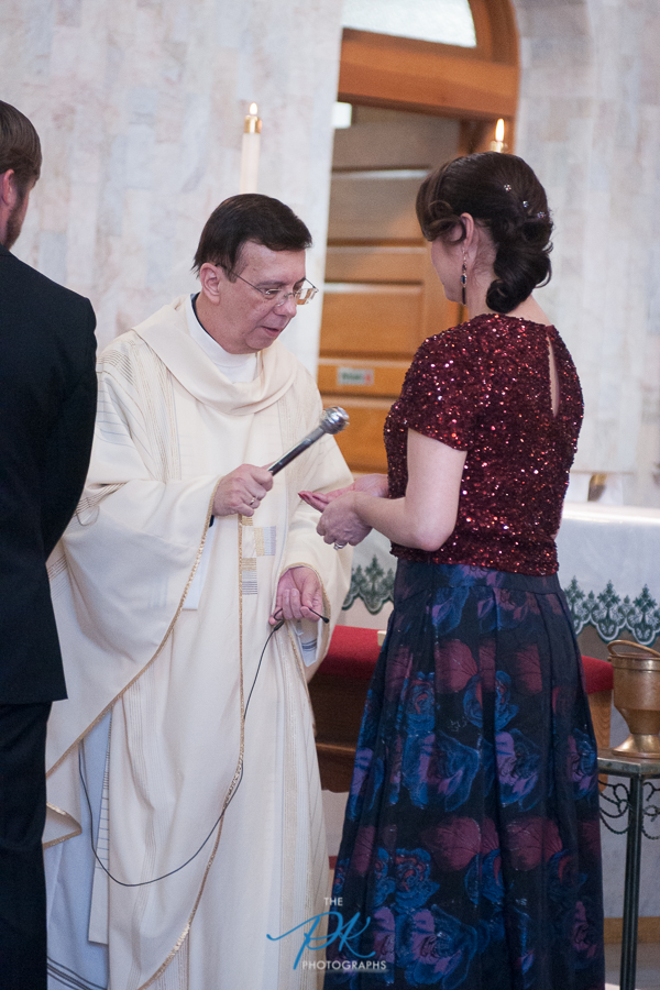 Blessing of the Rings During a Wedding at Immaculate Heart of Mary - San Antonio Wedding Photographer