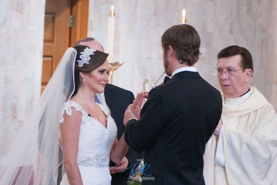 Exchanging Rings During a Wedding at Immaculate Heart of Mary - San Antonio Wedding Photographer