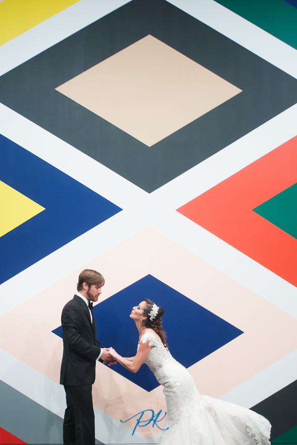 Bride and Groom Photographed in front of Stephen Westfall: The Holy Forest at the McNay Art Museum in San Antonio, Texas.