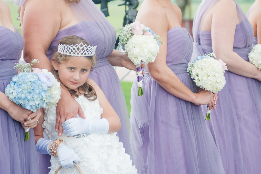 Flowergirl During a Wedding Ceremony at the Lodge at Country Inn Cottages | San Antonio Wedding Photographer