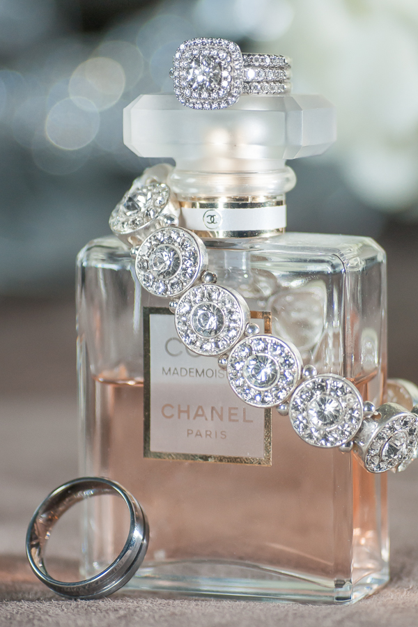 Wedding and Engagement Rings, along with the Bride's perfume and bracelet, photographed during Bridal Prep.