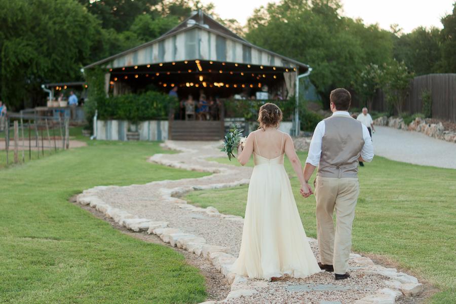Bride and Groom walking to their wedding reception   San Antonio Wedding Photographer
