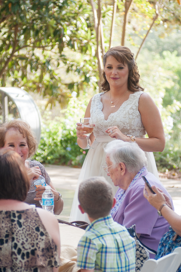 Bride talking with her guests during Cocktail Hour