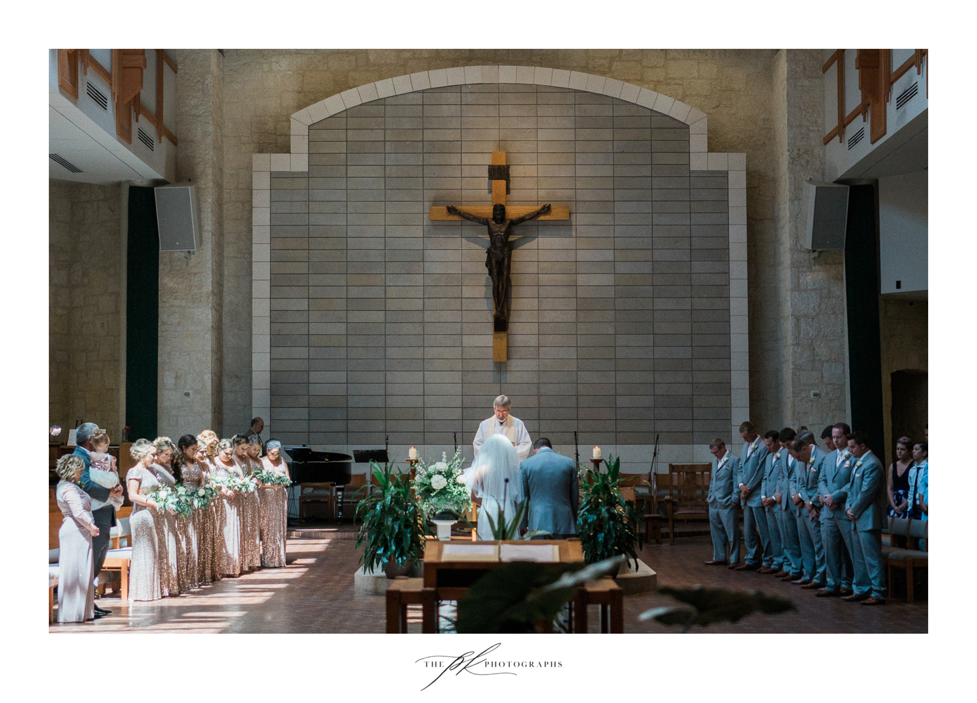 A stunning wedding ceremony, surrounded by their closest family and friends.  St. Peter the Apostle Catholic Church | San Antonio Wedding Photographer