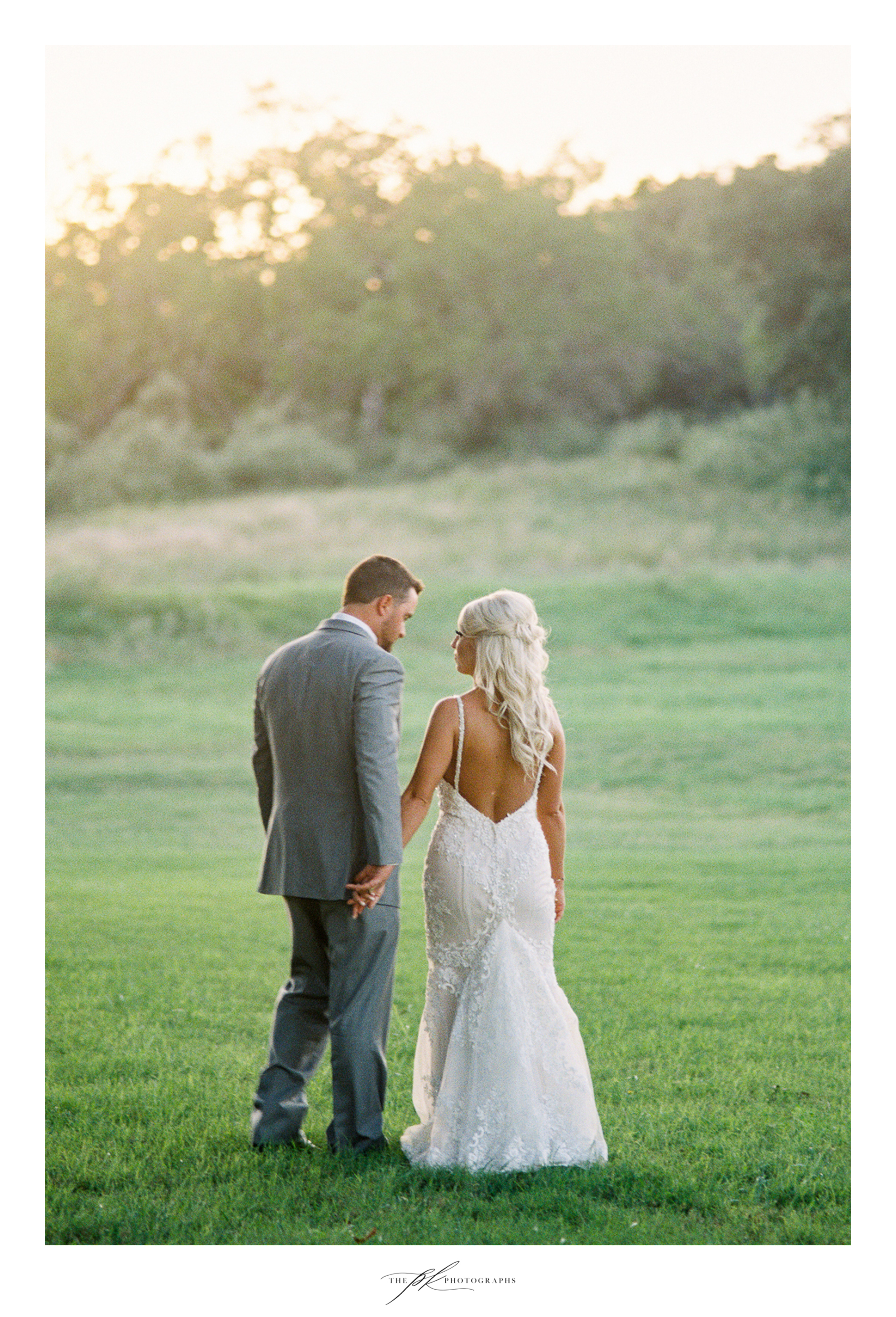 The sunset, the trees, and a couple deeply in love!  The Lodge At Country Inn Cottages | San Antonio Wedding Photographer