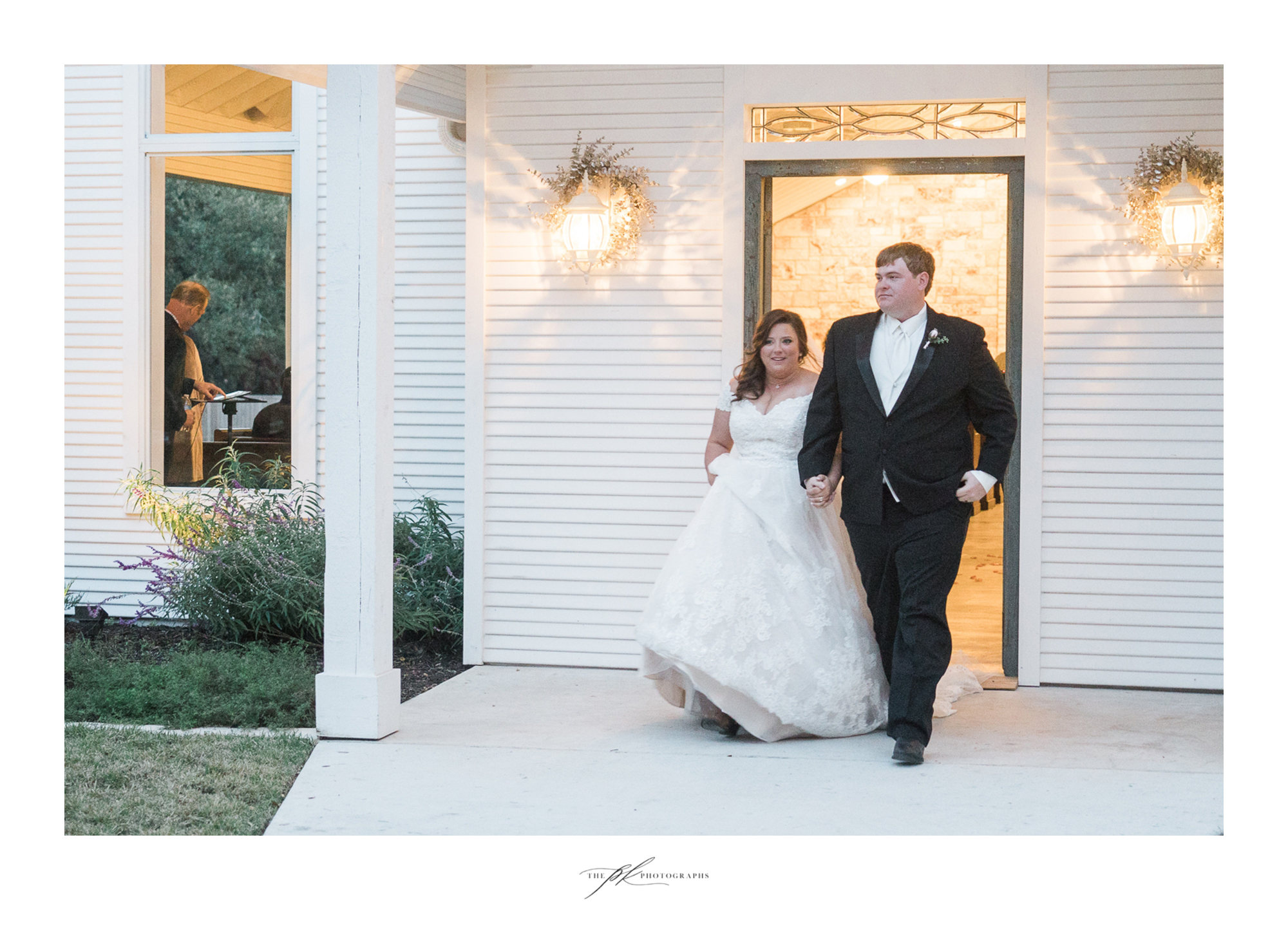 Emily and Lamar walking back up the aisle as husband and wife at their wedding ceremony in the open air chapel at the Chandelier of Gruene