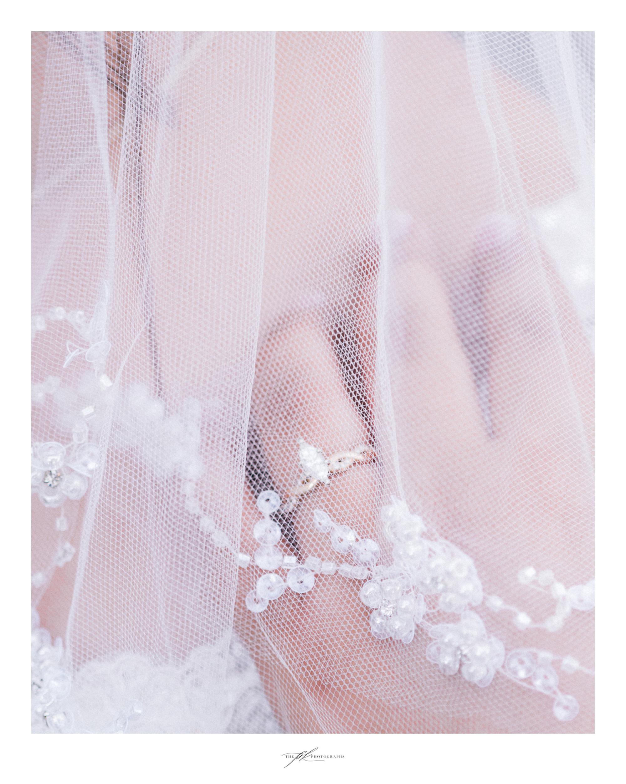 Emily's veil and custom designed engagement ring.