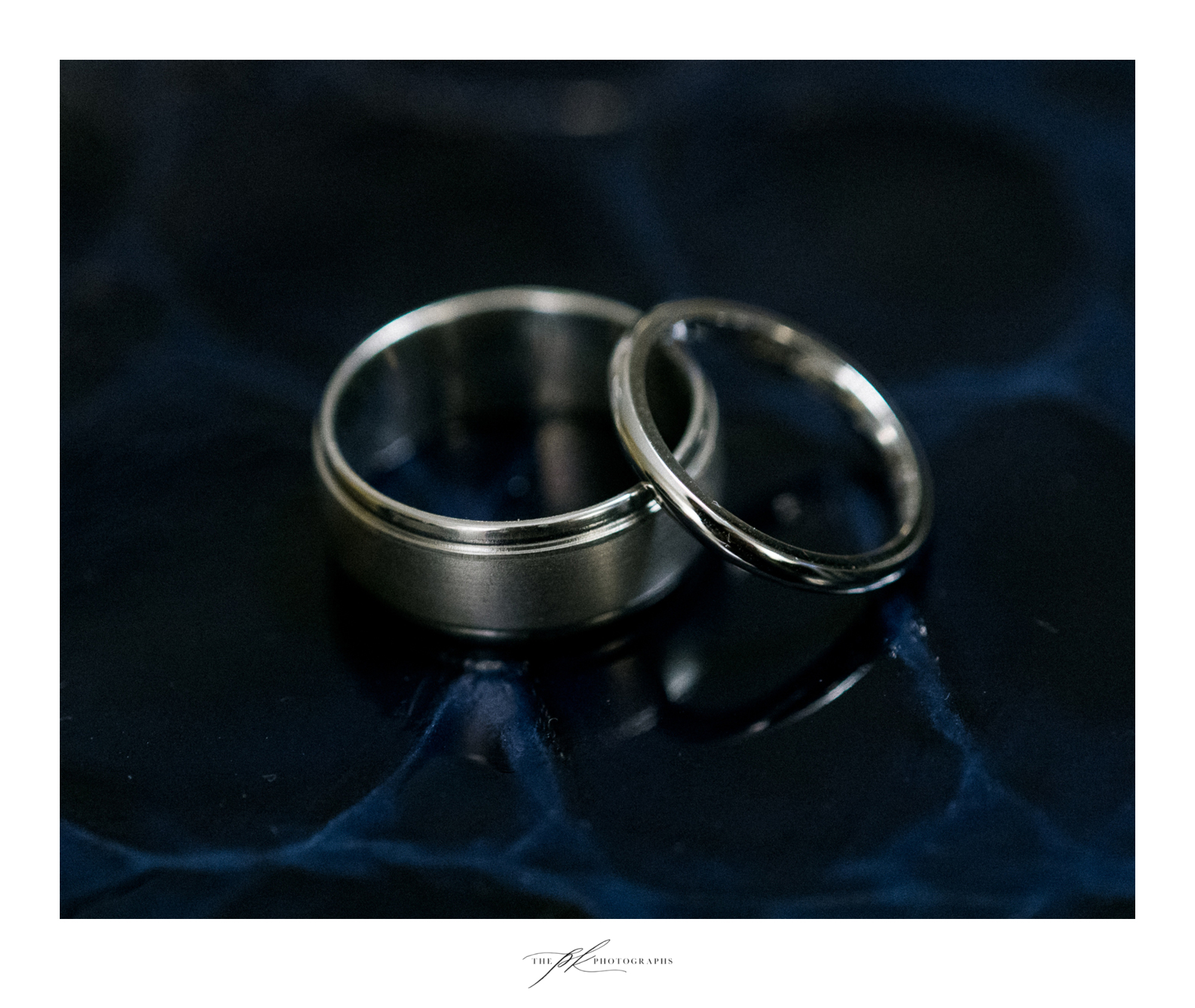 Bride and groom's silver wedding ring set.