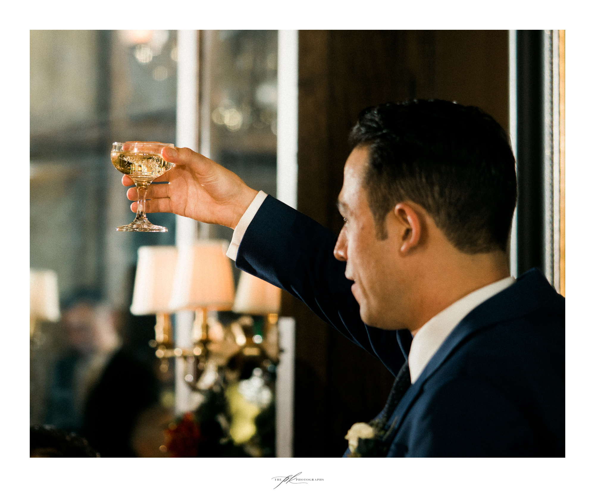 The groom toasting at his wedding reception.