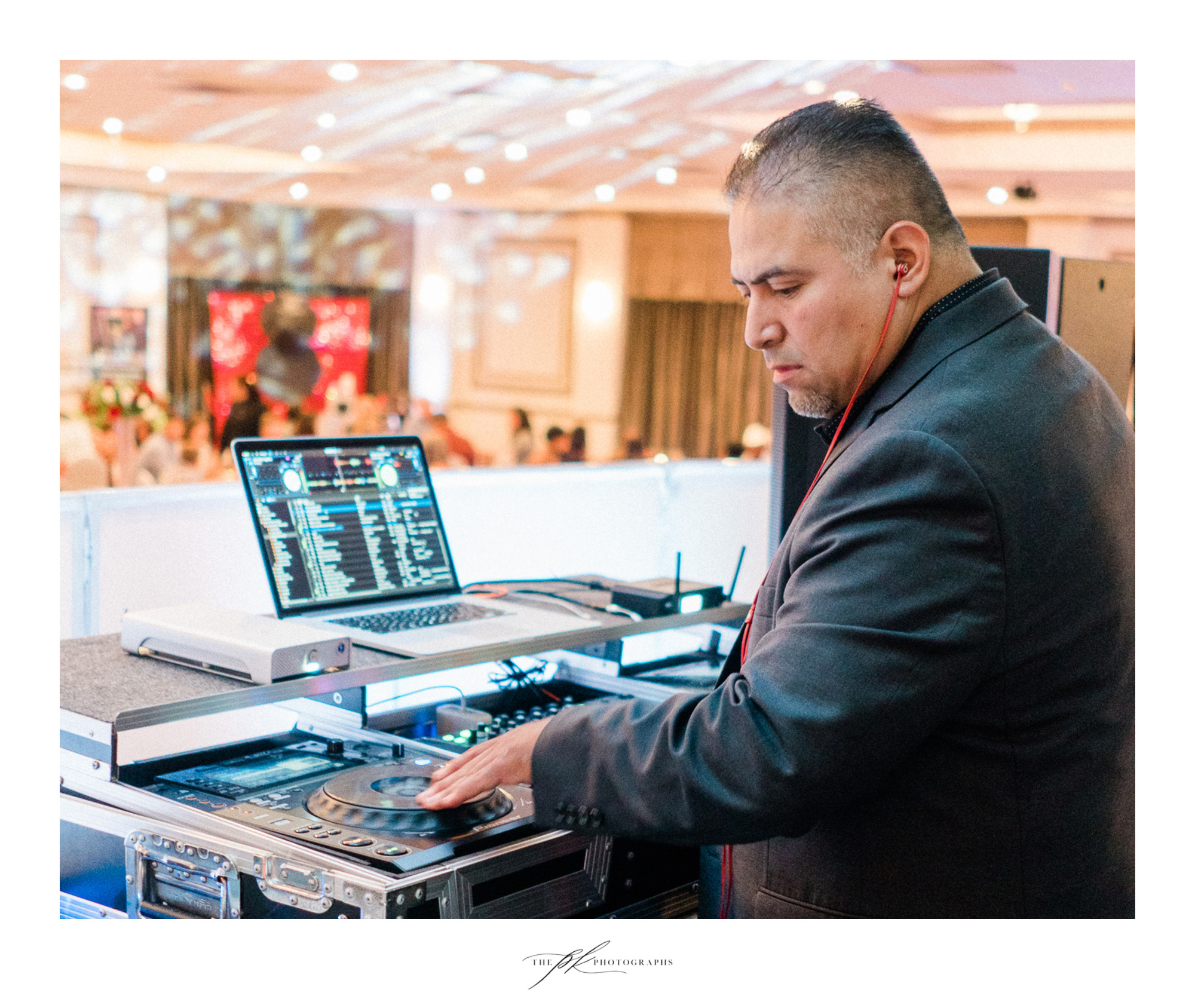 David of Power Sounds Event Entertainment, mixing music during dinner at a San Antonio wedding.
