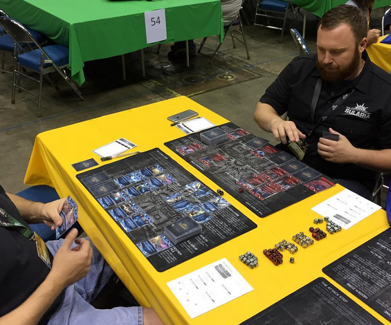 Frank Hruby shows a GenCon convention goer the ropes
