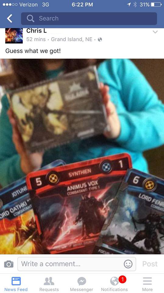 Chris L loves his new game and promo cards!