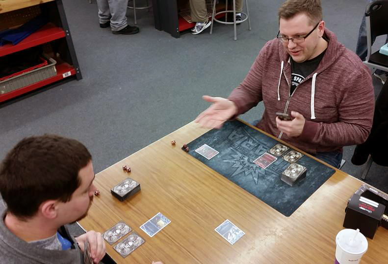 Creator & Lead Designer, Jesse Bergman, guides a new player through a demo at Gauntlet Games in Linconln, NE on Friday night.