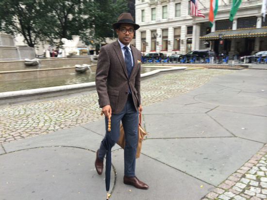 Brown Fedora by Selentino, Harris Tweed jacket by Bloomingdale's, Cashmere trousers by Brioni, Chukkas by Barney's, Umbrella by Kent Wang