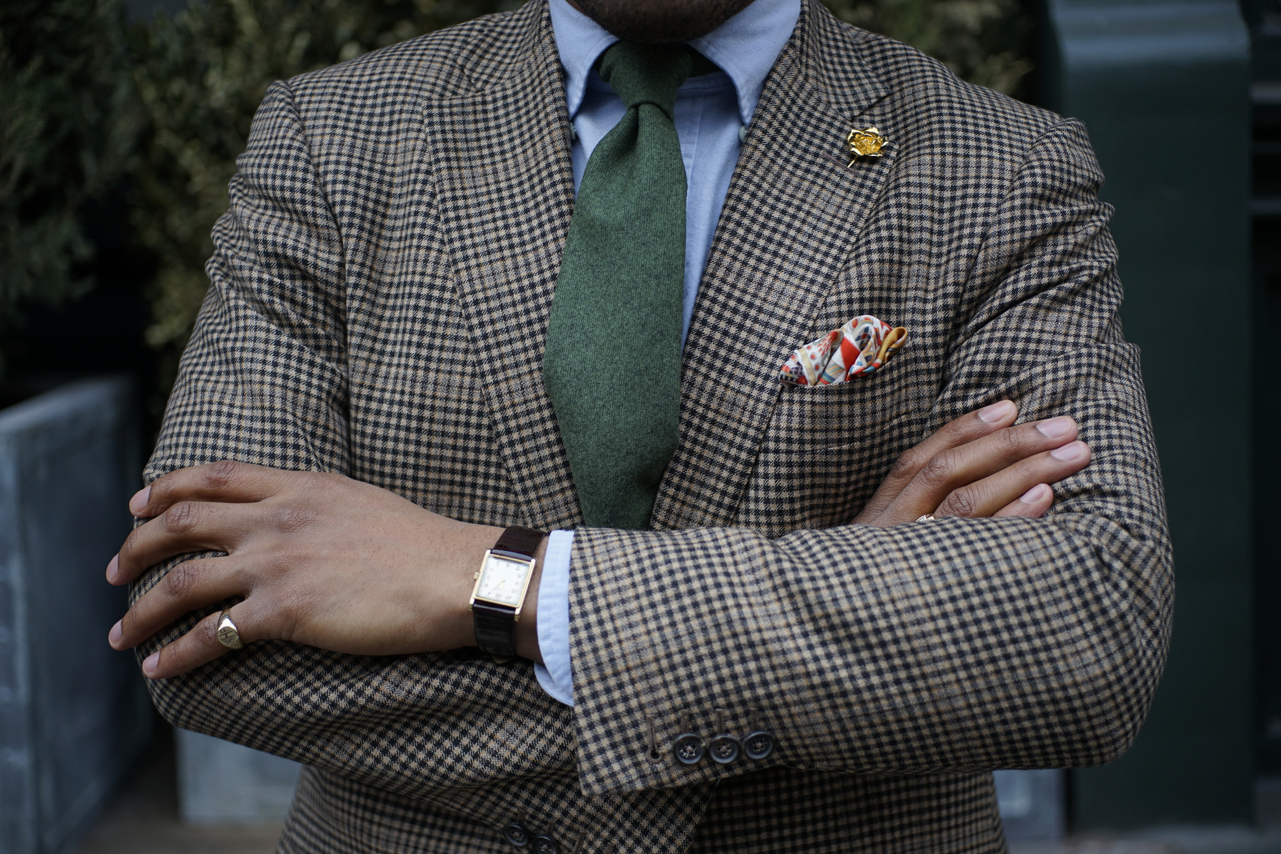 Coat by Isaia, shirt by Kamakura Shirts, Tie by Josiah France, pocket square by Kent Wang lapel pin by By Elias,
