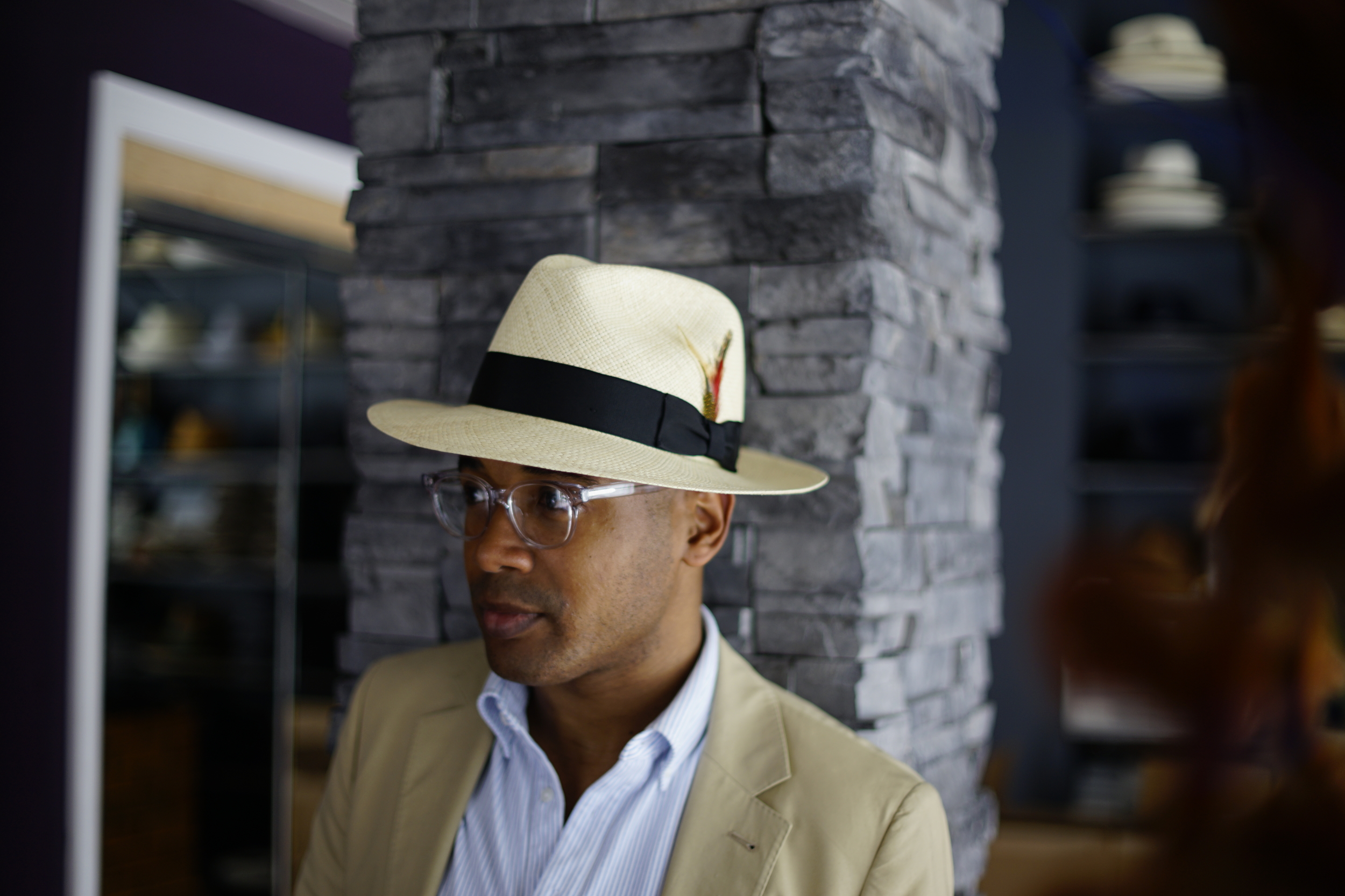 Panama hat by Flamekeepers Hat Club; frames by SEE Eyewear, jacket by Club Monaco, polo shirt by Uniqlo