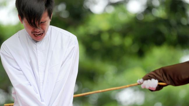 An Indonesian man is publicly caned for having sex in Banda Aceh. Picture: AFP