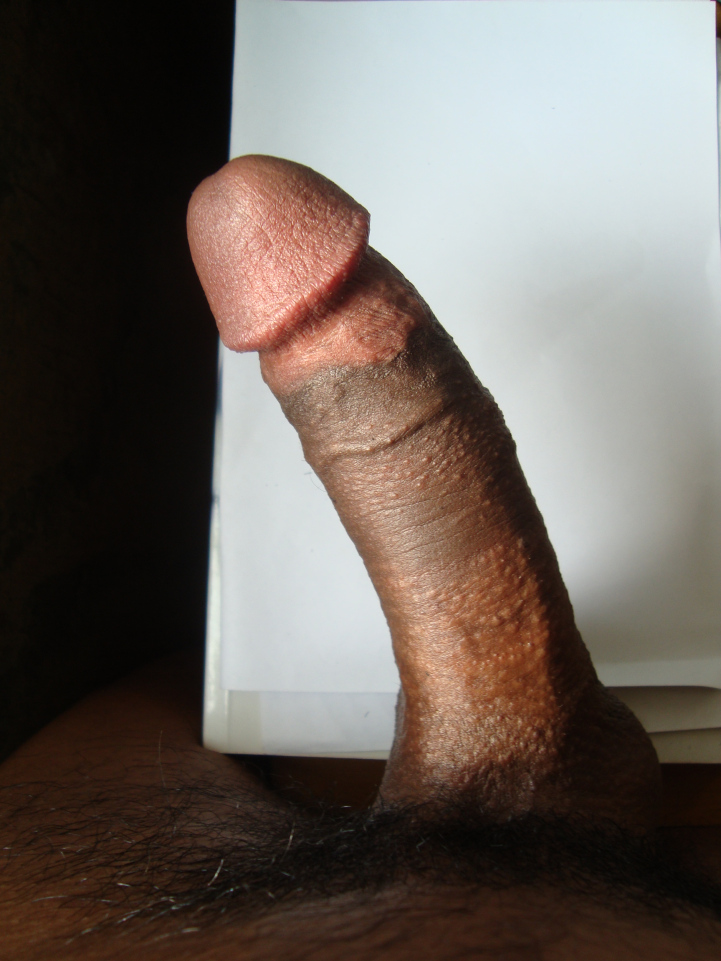close_up_detail_of_a_semi_erect_circumcised_penis_birdseye_view.jpg
