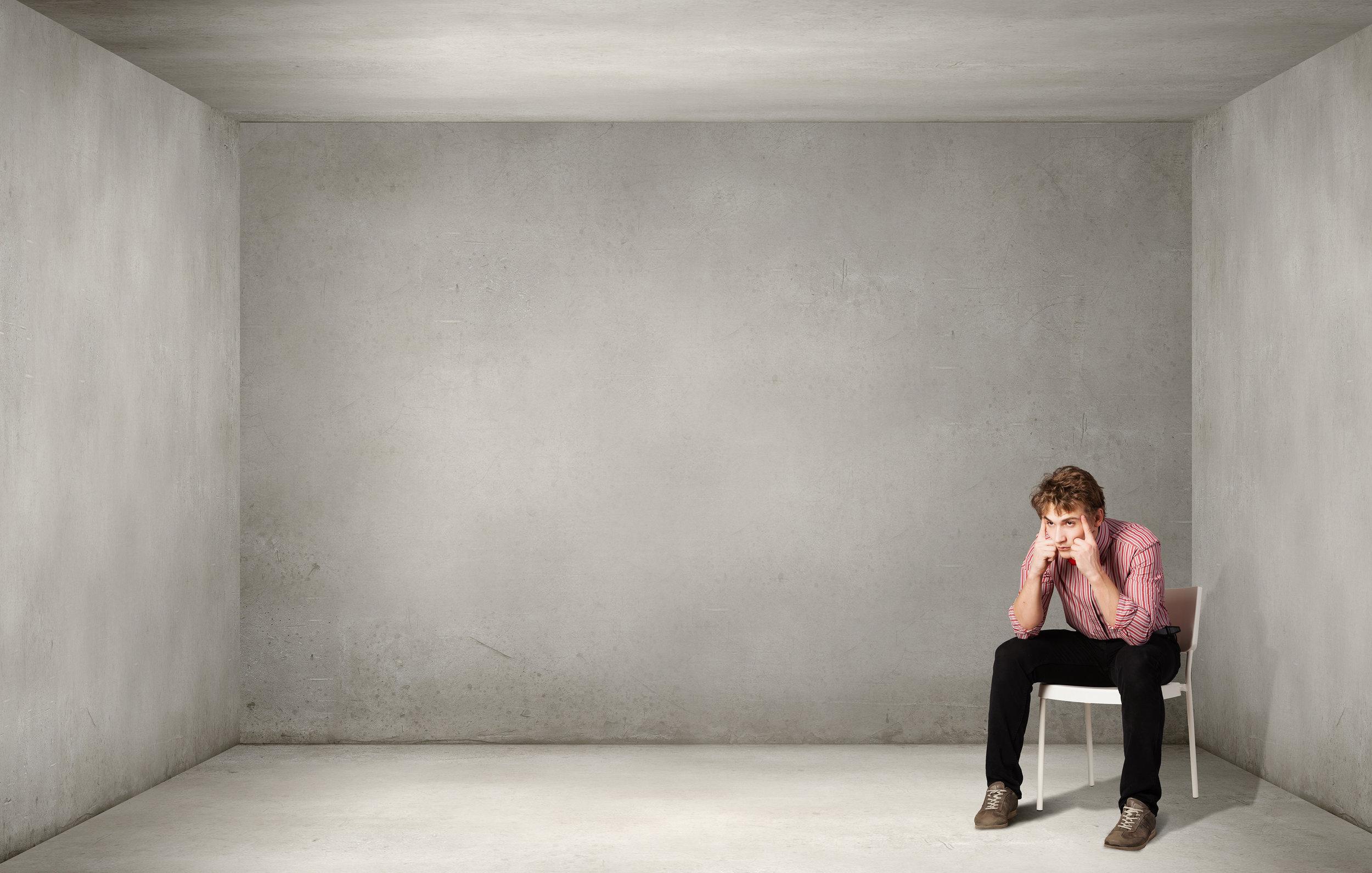 Depressed-man-sitting-on-a-cha-99057314.jpg