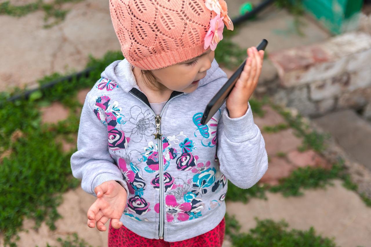 Image Description: Little Girl Talking on cell phone